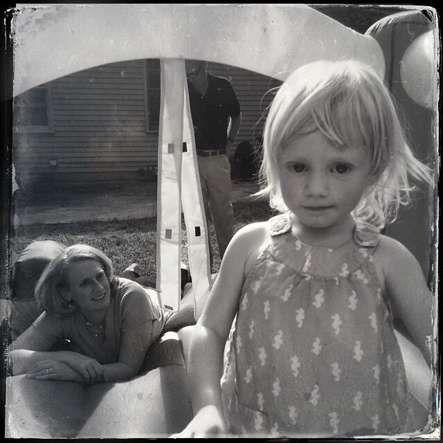 Mary gets serious for a moment in the bounce house.