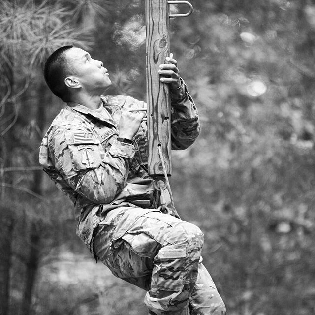 Staff Sgt. Rodney Cabebe, a radio/communications security repairer (94E) from A Co., Special Operations Aviation Training Battalion, climbs an obstacle during the Best Warrior Competition at Fort A.P. Hill. (Mike Morones/Army Times)