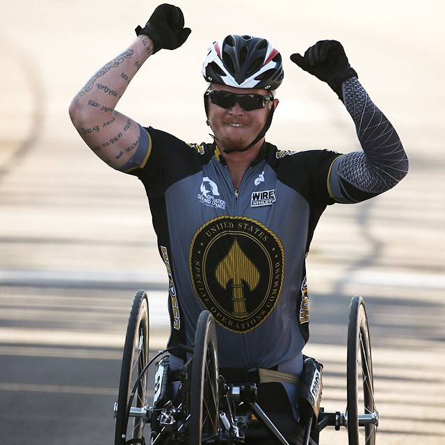 Retired Cpl. Justin Gaertner celebrates his first place win for Special Operations Command in cycling at