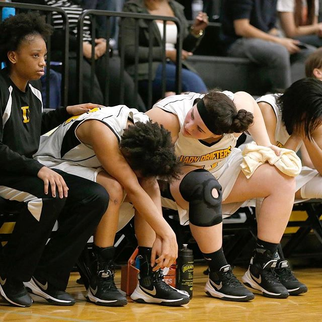 Colonial Beach's Murielle Gresham, left, and Tamra Ruczynski, center, console Alexia Wilson as Appomattox Regional Governor's School clinches a victory over the Drifters in the first round of the 1A East girls basketball tournament at Colonial Beach High School.
