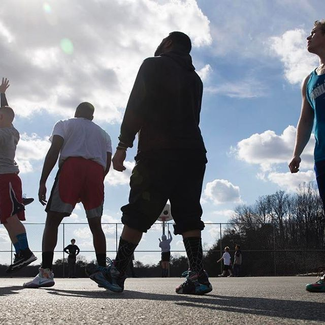 With temperatures in the mid-70's, players get a pick-up basketball game going at Loriella Park in Spotsylvania. (Mike Morones/The Free Lance-Star)