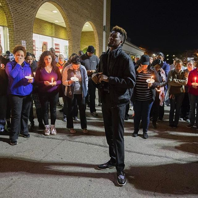 Le Vance Bell of Fredericksburg says a prayer during a candlelight vigil held to remember Larry Drumgole outside Burlington Coat Factory in Fredericksburg, Va. on March 9, 2017. Drumgole, a loss prevention specialist at the Burlington Coat Factory at Potomac Mills, was stabbed and killed by a shoplifter. Drumgole had previously worked at the Fredericksburg store. (Mike Morones / The Free Lance-Star)
