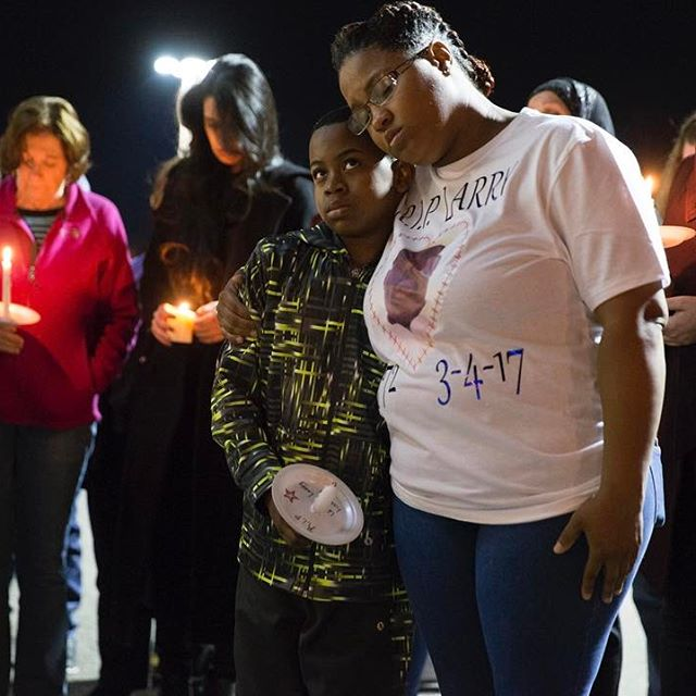 India Myers hugs Malachi Drumgole, 11, during a candlelight vigil honoring his father Larry Drumgole outside Burlington Coat Factory in Fredericksburg, Va. on March 9, 2017. Drumgole, a loss prevention specialist at the Burlington Coat Factory at Potomac Mills, was stabbed and killed by a shoplifter. Drumgole had previously worked at the Fredericksburg store. (Mike Morones / The Free Lance-Star)