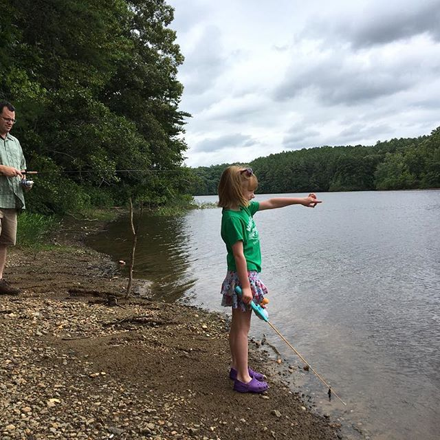 Mary tries her hand at fishing at Motts Run in Fredericksburg. Photo by Kelly
