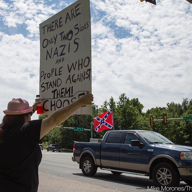 Kim Wyman of Spotsylvania joined more than 60 demonstrators gather at the intersection of the Blue and Gray Parkway and William Street in Fredericksburg, Va. on Aug. 13, 2017 to protest against hate and racism in the wake of violence in Charlottesville. (Mike Morones/The Free Lance-Star)